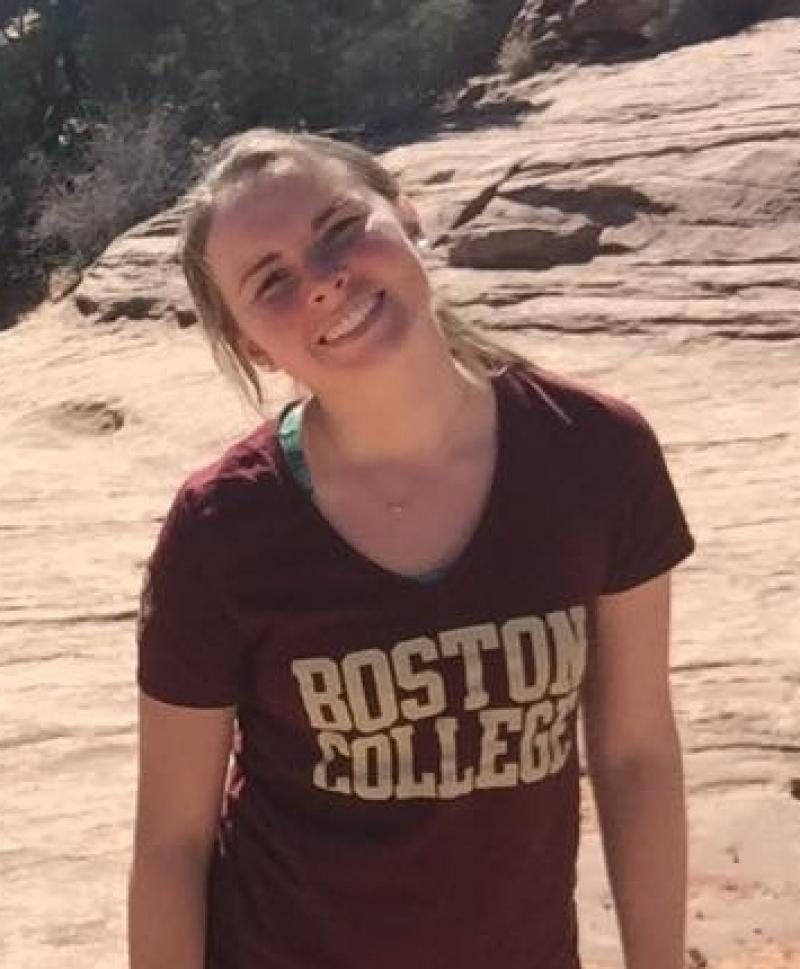 student wearing a Boston College shirt