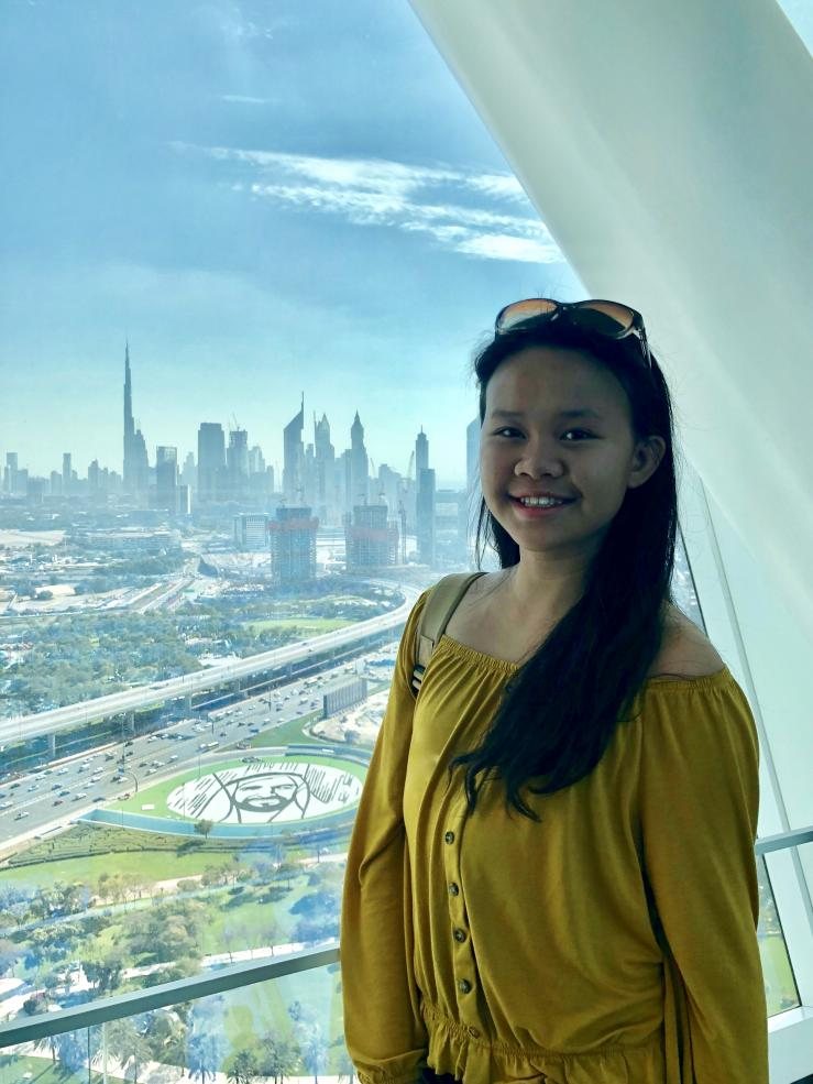 Student with Dubai skyline in the background
