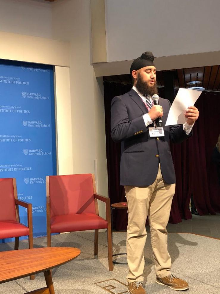 a student on stage at Harvard's JFK Jr. Forum