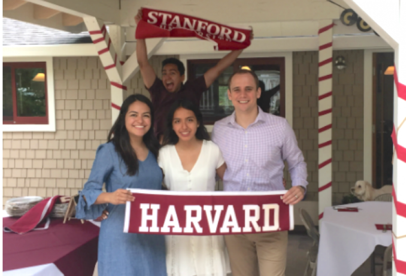 Students holding Harvard flag