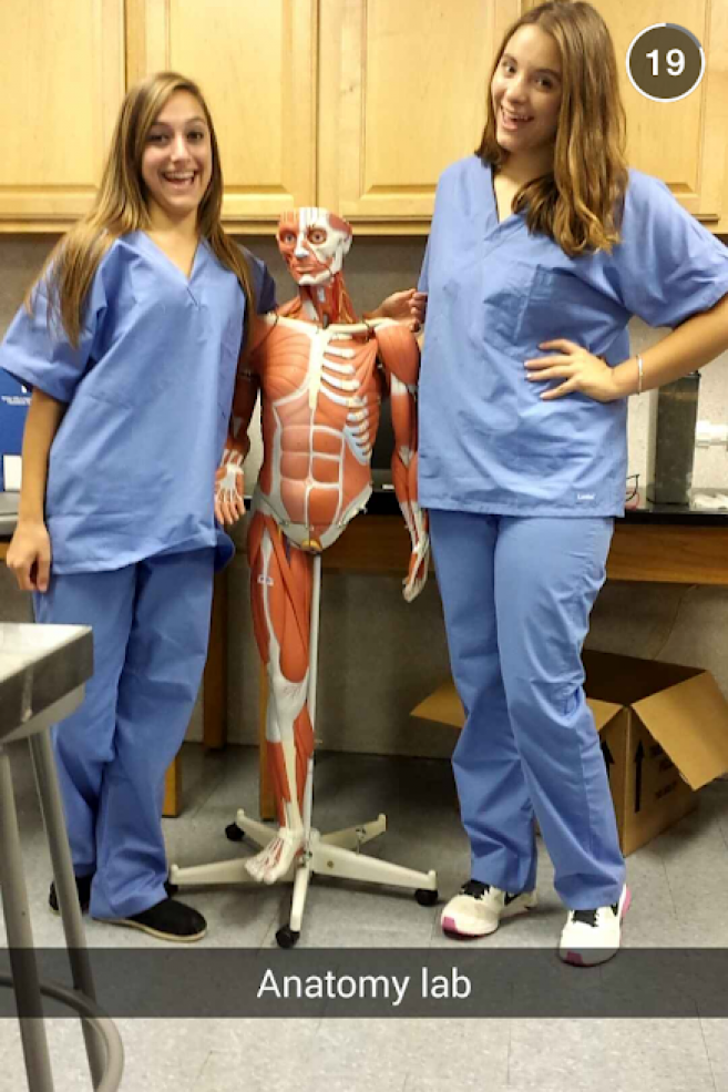 two students with an anatomy model in lab class