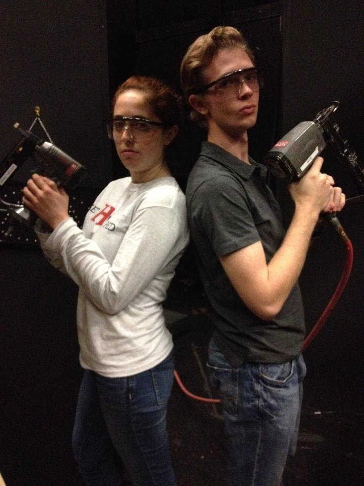 Picture of two students holding power tools