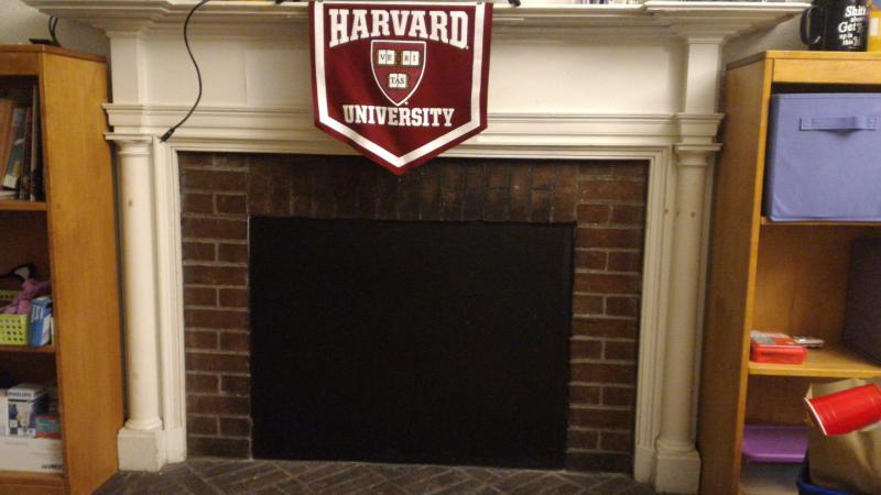 Photograph of boarded fireplace in author's dorm room