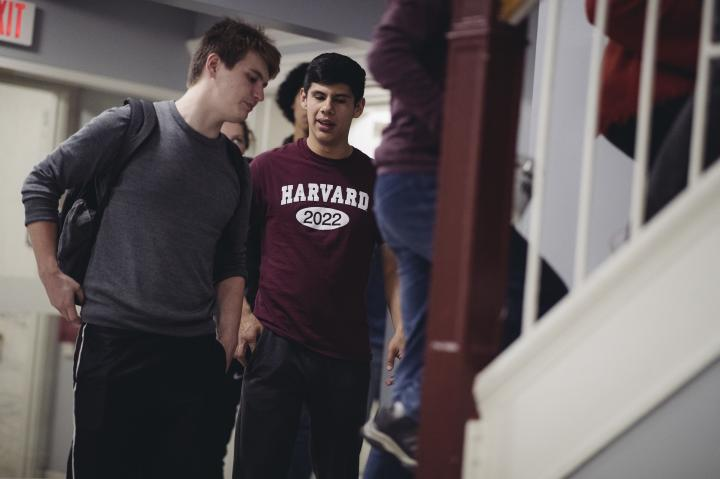 Two students walking up the stairs