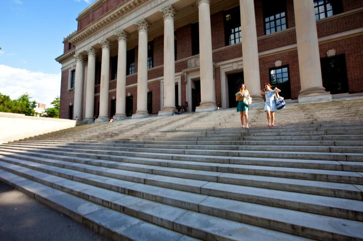 Two students walking down the steps of Widener Library