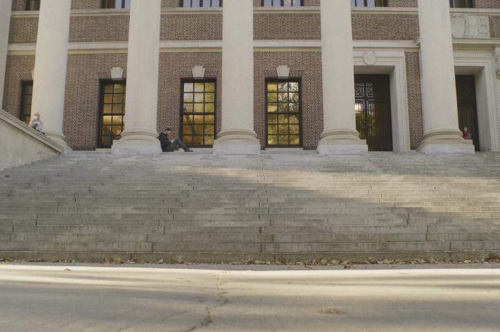 Student on the steps of Widener Library