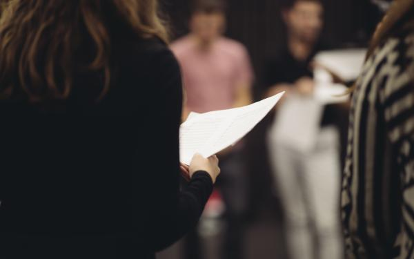 Close up of student holding a piece of paper