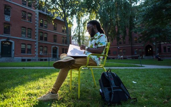 Student studying in Harvard Yard