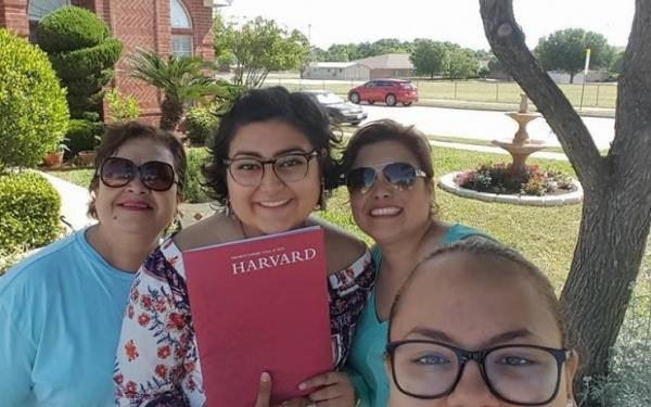 My family and I showing off my Harvard admitted student packet