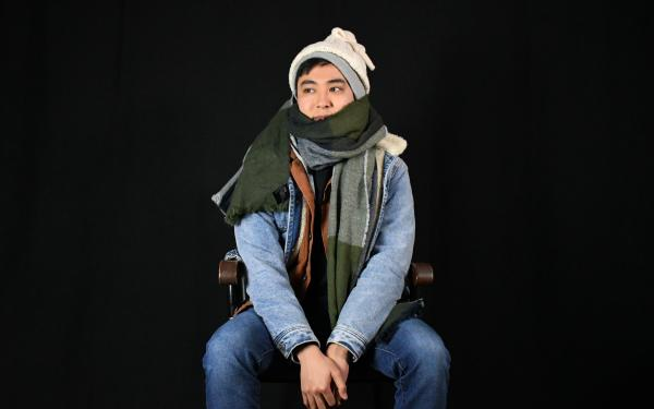 Person wearing many layers of clothing