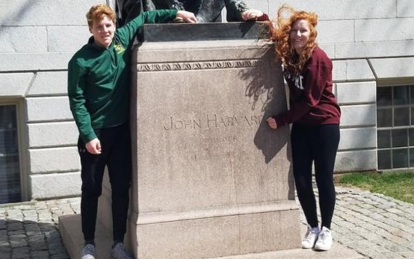 Allison and her brother with the John harvard statue