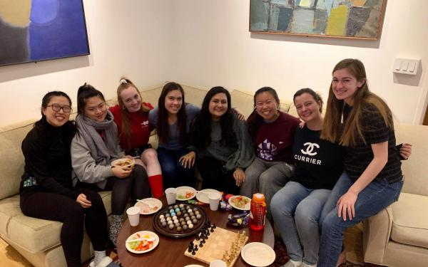 Maria posing with her friend group in Currier House, one of the upperclassmen dorms.