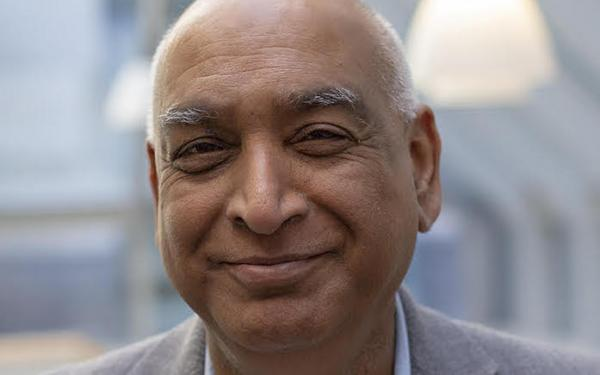 A headshot of professor Shiv Pillai.