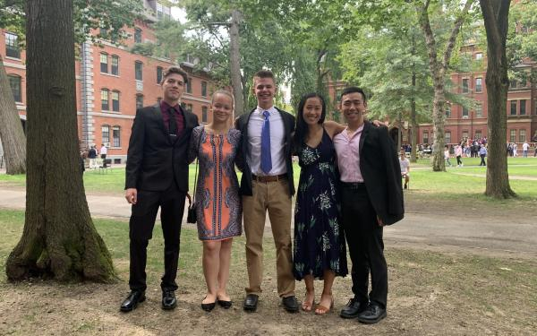 Five Harvard students posing in the Yard at Convocation