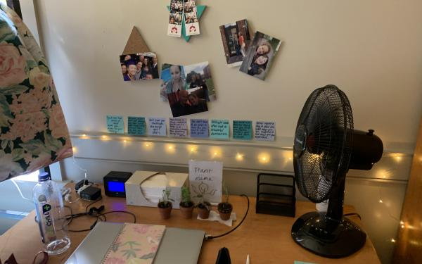 A desk and study space in a Harvard first-year student's dorm