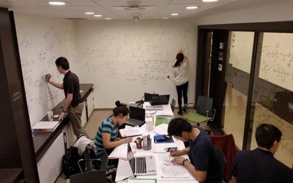 5 students studying in the basement of dorm.