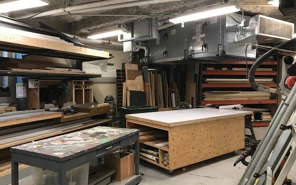The scene shop, with tables and saws and wood set up for set building