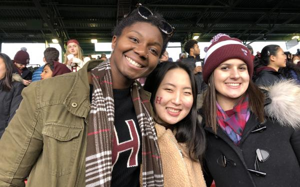 three students at the 2018 Harvard Yale game